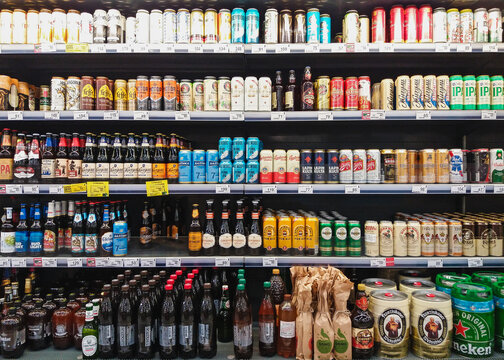 Beer in bottles and cans on grocery store shelves, Moscow 02072021