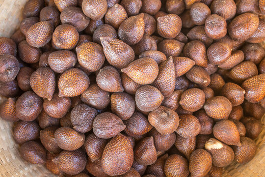 Salak fruits also known as snake fruit close-up in the basket