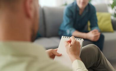 Fototapeta Professional therapist meeting a patient in his office obraz