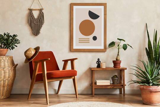 Creative composition of stylish living room interior with mock up poster frame, armchair, coffee table, cacti and personal and boho accessories. Plant love and nature concept. Template.