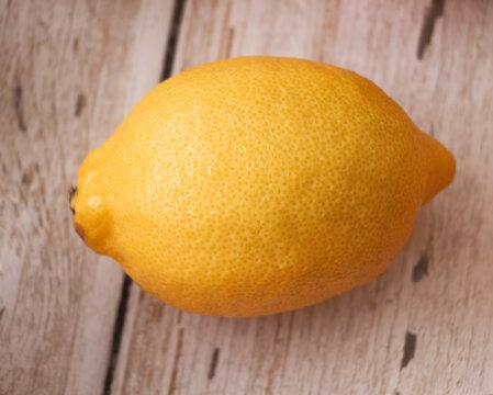 Lemon with rough yellow peel.plenty water drops around