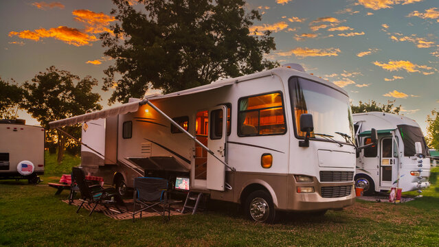 Sun going down at the Rv park with lights on the motor home