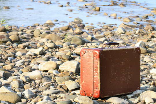 Old suitcase on the beach.