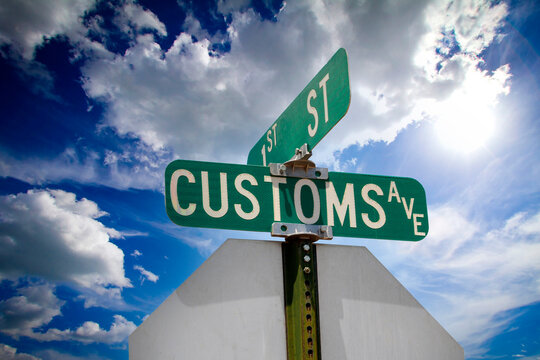 1st St and Customs Ave sign in Douglas, Arizona on the border of Mexico