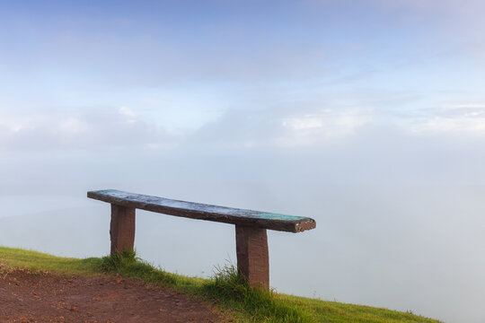 Empty wooden bench stands on the top of Montana Redonda
