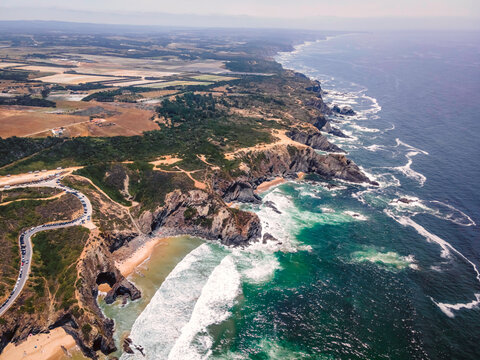 Aerial view of beautiful wild cliff coastline near Odeceixe, Faro, Portugal.