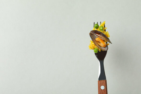 Fork with Spanish Paella on gray background