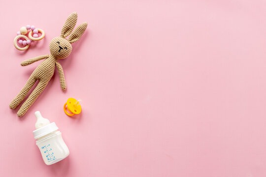 Knitted baby toy bunny with milk bottle, top view