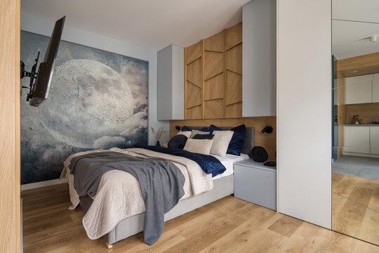 Stylish bedroom with wall decor