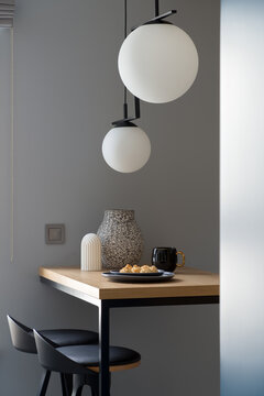 Decorations on table under modern lamps