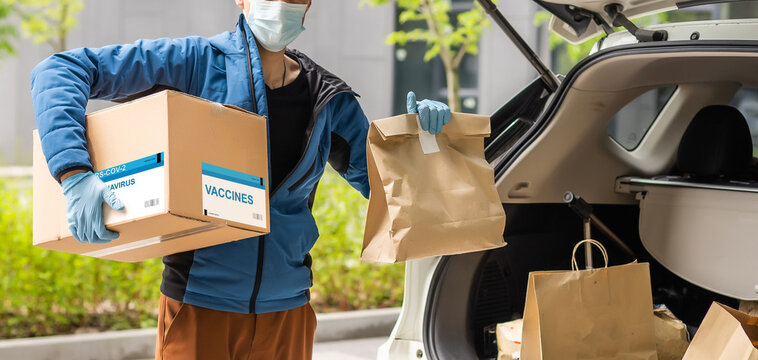 Contactless delivery during COVID-19 pandemic lockdown concept. Courier wearing mask and gloves deliver a parcel with medical equipment and to the customer