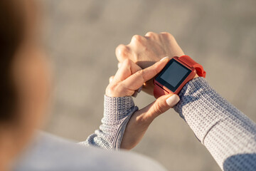 Fototapeta Close up picture of female hand with a smartwatch on it obraz