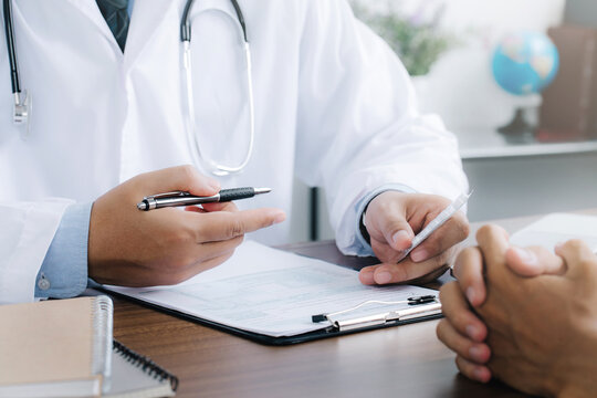 Doctor give recommend pills or drugs to unhealthy mature male patient in clinic.Caring doctor prescribe medicines to sick man client. healthcare concept.