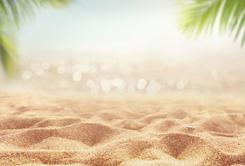 Beautiful background for summer vacation and travel. Golden sand of tropical beach, blurry palm...