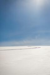 A ski track in the snow