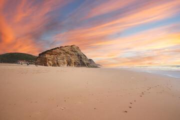 Beautiful sandy ocean beach and cliff at the sunset. Panorama atlantic