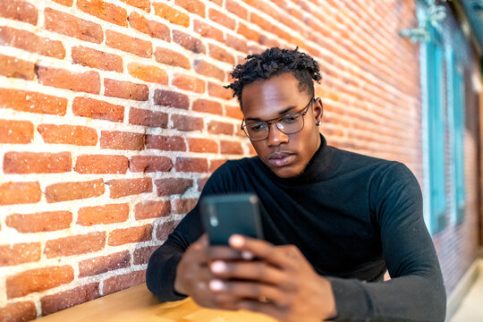 young african man working from his smartphone