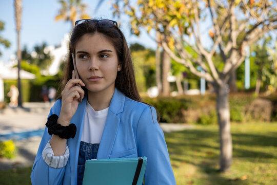 Student girl using technology at garden