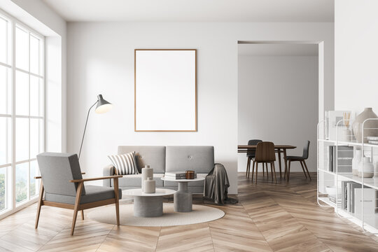 Mock up empty posters on the wall. Modern living room interior. Wooden floor and stylish furniture. Concept of contemporary design.