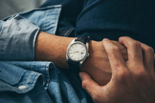 fashionable wearing stylish looking at luxury watch on hand check the time .concept for managing time organization working,punctuality,appointment