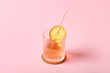 Glass of tasty cocktail on color background