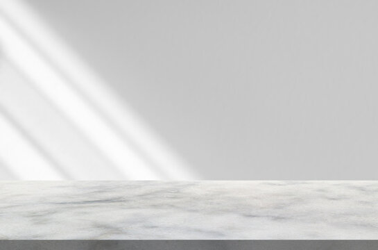 Marble table with window shadow drop on white wall background for mockup product display