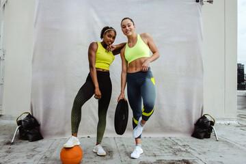 Fototapeta Female athletes posing after workout session obraz