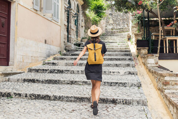 Fototapeta Travel concept, beautiful tourist woman walking in old town during vacation, cheerful student girl traveling abroad in summer obraz