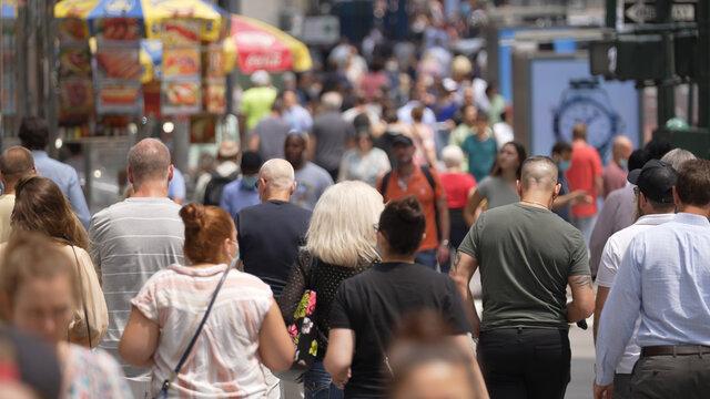 Anonymous crowd of people walking street