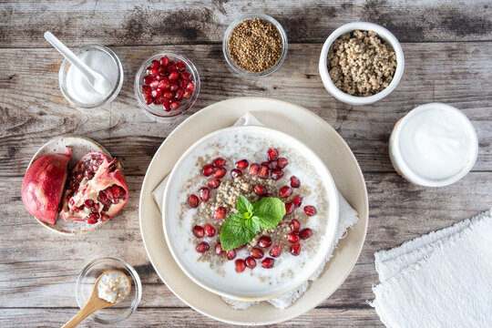 Close-up of a bowl of millet semolina with pomegranate seeds