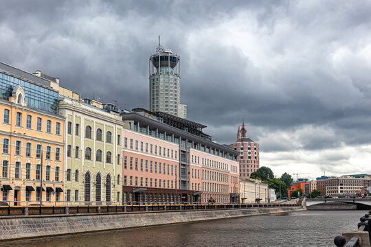 Houses on the embankment of the Drainage canal and the skyscraper 'Swissotel Krasnye Holmy'