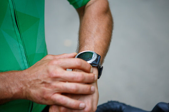 Cyclist cyclist cyclist athlete wearing a smartwatch gps activity tracker during bike training race