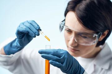 Obraz female laboratory assistant in white coat chemical solution test tube science - fototapety do salonu