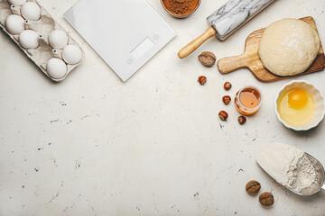 Fototapeta Ingredients for preparing bakery and utensils on light background obraz
