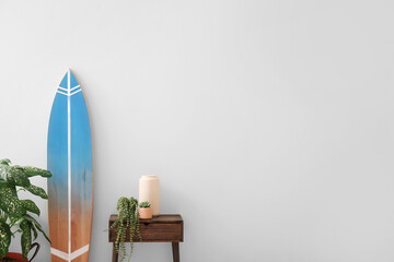 Interior of modern stylish room with table and surfboard
