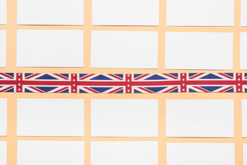 Fototapeta Blank business cards and strip in colors of UK flag on table. Concept of learning English obraz