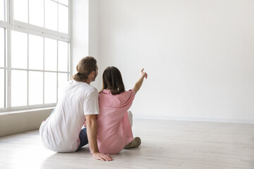 Fototapeta Young couple thinking about design of their new flat obraz