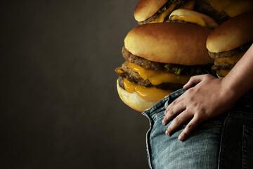 Fat man eating junk food