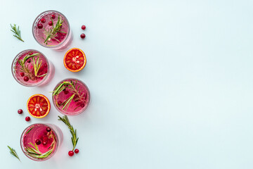 Fototapeta Red oranges refrashing drink lemonade with cranberry. Top view obraz