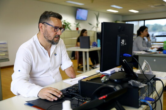 Rui Brito, a worker with a disability works at the office in Porto