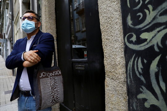 Rui Brito, a worker with a disability, stands outside a cafe after work amid the coronavirus disease (COVID-19) pandemic in Porto