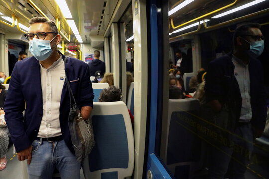 Rui Brito, a worker with a disability, travels in a subway after work in Porto