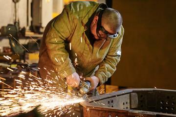 Fototapeta Grinding metal in the factory obraz