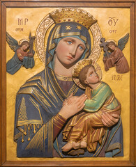 VIENNA, AUSTIRA - JUNI 24, 2021: The relief of Madonna (Our Lady of Perpetual Help) in the Pfarrkirche St. Thekla church by unknown artist.