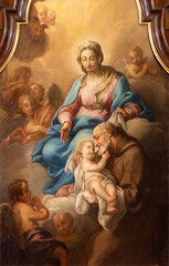 VIENNA, AUSTIRA - JULI 5, 2021: The detail of painting of Holy Family in the church Kapuzinerkirche by capuchin Norbert Baumgartner from 18. cent..