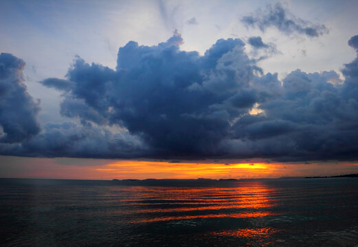 Beautiful scenic landscape with dramatic cloudy sky at sunset and a sun glade on a ripple sea water in Sihanouk ville, Gulf of Thailand, Pacific Ocean, Cambodia, South East Asia