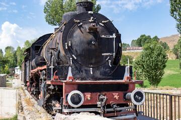 Two hundred years old train in muradiye district of van province. Turkey. locomotive in black color.
