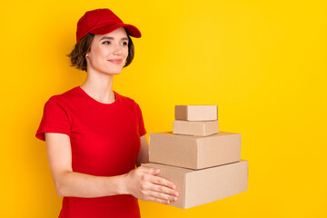 Profile photo of nice optimistic brown hair lady hold box wear t-shirt cap isolated on yellow background Wall mural