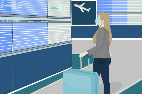 woman traveler wear protective mask for protect covid 19 virus with hold her luggage see information screen in airport