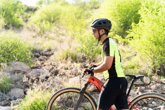 Attractive athlete finishing his bike training